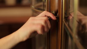 Woman covers vintage key glass door. stock video