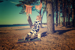 Woman in cow pajamas in a hammock Royalty Free Stock Photo