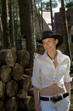 Woman-cowboy. Portrait of a woman in a white shirt and cowboy hat on a ranch Stock Image