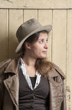 Woman in cowboy coat and hat Royalty Free Stock Images