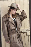 Woman in cowboy coat and hat Royalty Free Stock Image