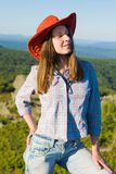 Woman in cowboy hat Stock Photos