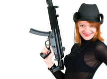 Woman in a cowboy hat. Red young woman in a cowboy hat holding the gun Royalty Free Stock Images