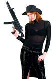 Woman in a cowboy hat. Sexy red young woman in a cowboy hat holding the gun Royalty Free Stock Image