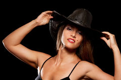 Woman in a cowboy hat. On black background Stock Photography
