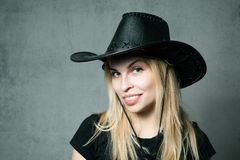 Woman with cowboy hat. On gray background. With place for text Royalty Free Stock Image