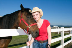 Woman in Cowboy Hat With Horse - Horizontal Stock Photo