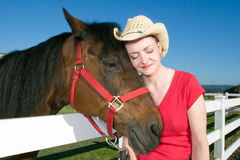 Woman in Cowboy Hat With Horse - Horizontal Royalty Free Stock Photo