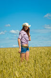 A woman in a cowboy hat and jeans shorts Stock Image