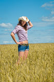 A woman in a cowboy hat and jeans shorts Royalty Free Stock Photography