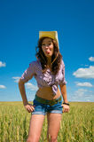 A woman in a cowboy hat and jeans shorts Stock Photos