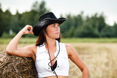 Woman in cowboy hat. An outdoor scene Royalty Free Stock Image