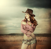 Woman in cowboy hat and sexy shorts. Young sexy Woman wearing cowboy hat and sexy shorts outdoor Stock Images