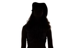 Woman in cowboy hat - silhouette Stock Images