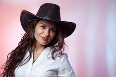 Woman with cowboy hat. Smiling woman with cowboy hat Stock Photography