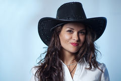 Woman with cowboy hat. Smiling woman with cowboy hat Royalty Free Stock Images