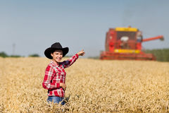 Woman with cowboy hat in wheat field Stock Photography