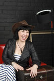 Woman in a cowboy's hat. Woman laughs in a cowboy's hat Royalty Free Stock Photography