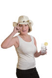 Woman with cowboyhat and longdrink Stock Photos