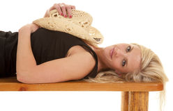 Woman cowgirl hat on chest lay Stock Image