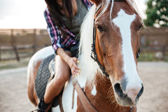 Woman cowgirl riding beautiful horse in village Royalty Free Stock Photos