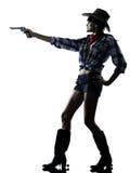 Woman cowgirl shooting gun revolver Stock Image