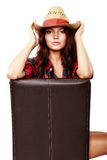 Woman cowgirl sitting on a chair isolated on white Stock Images