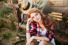 Woman cowgirl sitting and relaxing outdoors Royalty Free Stock Images