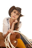 Woman cowgirl white blouse rope on saddle look Stock Images