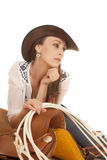 Woman cowgirl white blouse on saddle look side Stock Image
