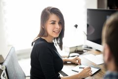 Woman and coworker at their workplace Royalty Free Stock Image