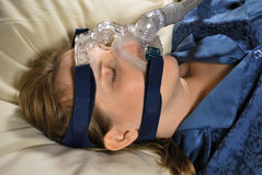 Woman with CPAP Mask. Woman asleep with CPAP machine Stock Photos