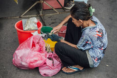 Woman crack fresh oysters at morning market in George Town. Penang, Malaysia.  Royalty Free Stock Images