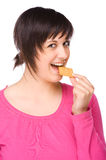 Woman with cracker. Full isolated portrait of a beautiful caucasian woman eating some cracker stock image