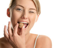 Woman cracking walnut Stock Photo
