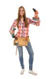 Woman in the craft with drill. Craftswoman with the tool belt and two screwdrivers in his hand Stock Photo