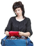 Woman crammed full of clothes Royalty Free Stock Image