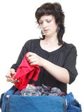 Woman crammed full of clothes and shoulder bag isolated Royalty Free Stock Image