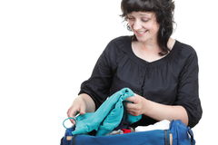 Woman crammed full of clothes and shoulder bag isolated Royalty Free Stock Photography