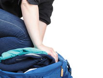 Woman crammed full of clothes and shoulder bag isolated Royalty Free Stock Photos
