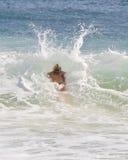 Woman crashing into a wave Royalty Free Stock Image