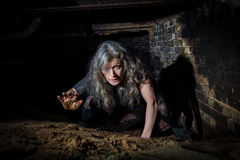 Woman crawling in Derelict Building. Urbex urban explorer Royalty Free Stock Photos