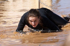 Woman crawling on a mud puddle royalty free stock photos