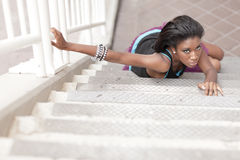 Woman crawling on a staircase Royalty Free Stock Images