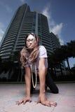 Woman crawling in an urban setting Stock Photo