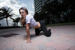 Woman crawling in an urban setting Royalty Free Stock Image