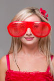 Woman in crazy clown glasses Stock Photography