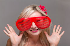 Woman in crazy clown glasses Royalty Free Stock Photo