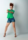 Woman crazy hair gun. Portrait of young woman with  with finger guns shooting with hair stand on end Royalty Free Stock Photography