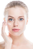Woman with cream on face Royalty Free Stock Photography